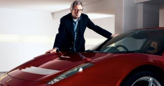 Eric Clapton stand along with his Ferrari