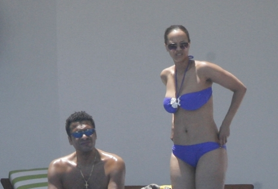 Tyra Banks was spotted in a purple bikini splashing in the beaches of Cancun and Cozumel
