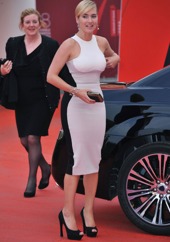 Ms.Winslet was spotted wearing peep toe pumps with a high platform front from Yves Saint Laurent.