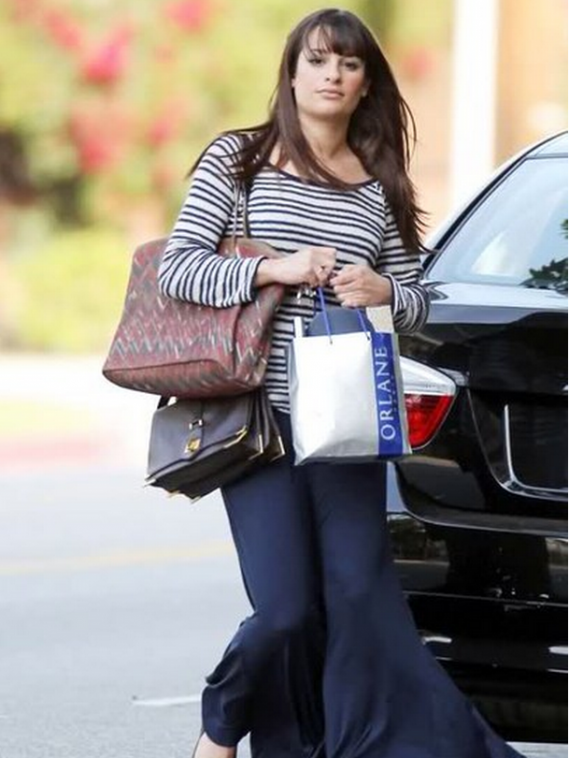 Michele has been photographed quite often embarking on shopping jaunts in her black $45000 BMW 320d.