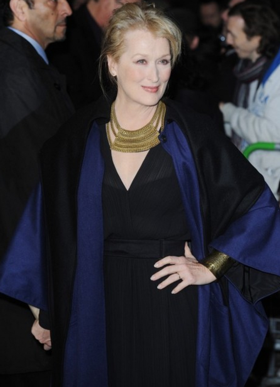 "Meryl Streep hit the red carpet at the British premiere of ""The Iron Lady"" wearing a stylish two-tone wool cloak by Lindsey Thornburg."