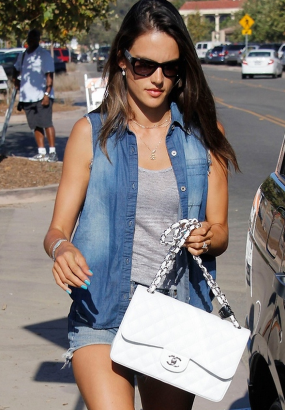 Getting into her car on a sunny day, Ms.Ambrosio was spotted in a stylish denim vest which came along with collar tips.