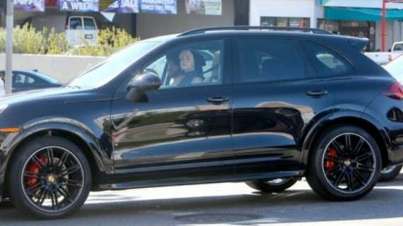 American actress and singer-songwriter Miley Cyrus purchased a metallic black $90,000 Porsche Cayenne in November 2012.