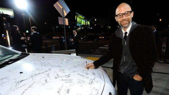 Singer Moby signs the Chrysler 300 on the celebration of Artists for Peace and Justice