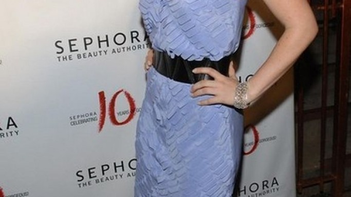 Natasha Bedingford struck a lovely pose in a dainty, blue mermaid dress from Madison Marcus.