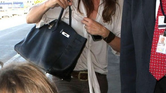 The black birkin bag from Hermès is one of Cindy's favorite side accessories to travel with.