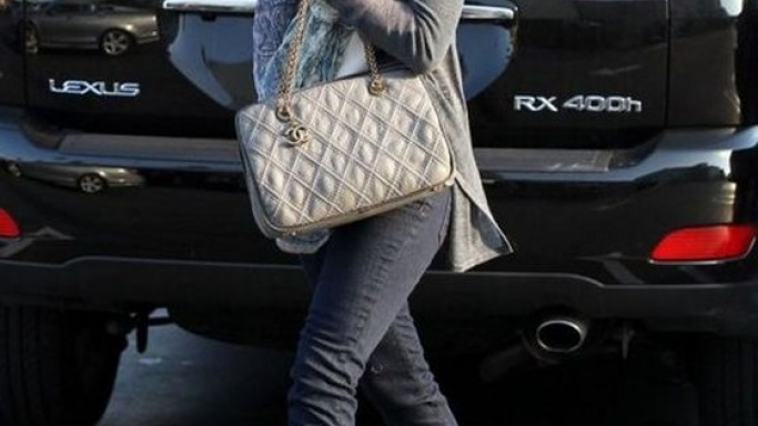 Walking out of her Lexus car, Ms.Hannigan was spotted with a shoulder strap bag from the Parisian fashion house, Chanel.